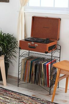 Record Storage Shelf. I know, I know. It's from Urban Outfitters. But it's simple, classic, and only $80 (which isn't great, but it's certainly not terrible)