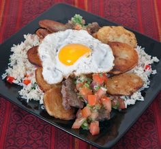Silpancho: Bolivian dish of rice, fried potatoes, breaded & fried beef, salsa and a fried egg. Latin American Food, Latin Food, Rice Dishes, Food Dishes, Fried Beef, Fried Rice, Bolivia Food, Venezuelan Food, Comida Latina