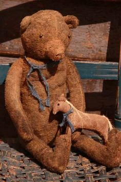Old Ted E. Bear...with a toy horse.