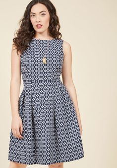 <p>This navy blue frock's tailored bodice and white, brocade diamond pattern are stylishly sophisticated enough to withstand the pressures of today's presentation. But, at an al fresco outing is when the tasteful V-back and classic skirt pleats of this pocketed dress truly shine! We'll raise our iced tea to that!</p>