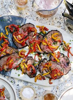 Tie the beef at intervals with string to keep its shape when cooking.Place the beef in a large sealable plastic bag. Whisk all the marinade ingredients together then pour into the bag, over the beef. Remove all the air and ...
