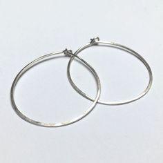 Timeless hammered hoop earring, approximately 1 in diameter. Hammered Silver, Mixed Metals, Silver Hoop Earrings, Metal Working, Bracelets, Jewelry, Jewlery, Metalworking, Jewerly