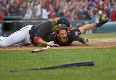 PILE AT THE PLATE:    Jayson Werth of the Washington Nationals, top, celebrates with Bryce Harper after Harper scored the game-winning run on a double by Daniel Murphy during the 10th inning against the Philadelphia Phillies on April 14 in Washington. The Nationals won 3-2.