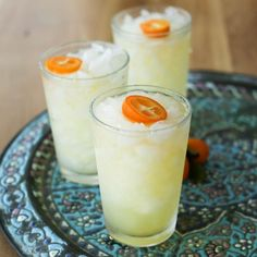 Kumquat margaritas! Kumquats are a tiny citrus fruit that goes perfectly in a margarita. Muddled fresh kumquats, tequila, orange liqueur and lime juice all shook up and served on the rocks. Perfect spring cocktail