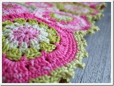 apple blossom hexagons finished off  with two rows of sc's and one row of small picots