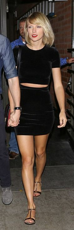 Who made  Taylor Swift's black velvet tee, mini skirt, pearl flat sandals, and red handbag?