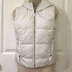 NWT! Express Winter Puffy Vest White hooded vest with lime green zipper. New with tags. Size XS. Two inside pockets as well. Small spot on right pocket and zipper tag from zipper color. Express Jackets & Coats Vests