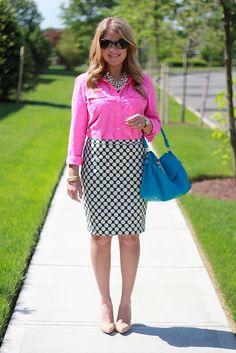 pink blouse, navy/white dot skirt