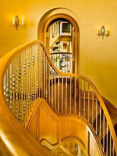 it really draws my attention to the room. the stair case railings all lead to the open room. it is really abtract because of the angle it was taken at with the railing coming towards the person taking the photo