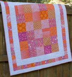 charm pack quilt -- not too fond of the colors, but I like the simple layout. I'm picturing teal and teal on white.