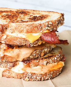bacon cheddar grilled cheese sandwiches with a sweet mustard sauce - be sure to use oat whole wheat bread for a crunchy twist to the classic!