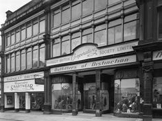 size: Photographic Print: Exterior of the Barnsley Co-Op Central Mens Tailoring Department, South Yorkshire, 1959 by Michael Walters : Barnsley South Yorkshire, Hall House, Shop Fronts, Tropical Art, Blackpool, Beach Landscape, Vintage Shops, Countryside, Scenery
