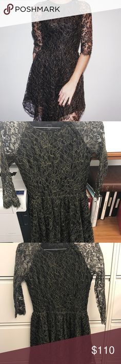 Dolce Vita Alondra Lace Dress. Sheer raglan sleeves. Fit and flare style dress with floral Lace in black and gold. Ruched waist drapes to a center point with an asymmetrical hem. Covered buttons detail the one shoulder. Hidden side zipper. Lined. Fits true to size. Worn 2x. Dolce Vita Dresses Mini