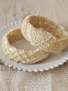 Bracelets  These inexpensive plastic bracelets are wrapped in a strip of cut lace that is secured inside with a hot-glue gun.        Read more: Lace Bracelets - Fun Craft Ideas - Country Living