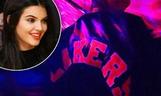 Kendall Jenner wears a Lakers jacket