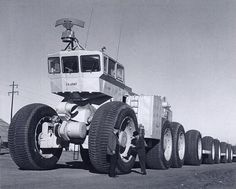 The fates of the Tournatrain and the Sno-Buggy are uncertain. The Sno-Freighter, however, sits abandoned with at least three of its trailers outside of Fairbanks, Alaska, as does the LCC-1, with just one of its trailers. The Overland Train, minus all of its trailers, sits today at the Yuma Proving Ground Heritage Center in Arizona. BigLorryBlog also has more photos of the Overland Train in another recent post, and LIFE shot a series of photos of the Overland Train testing at Yuma