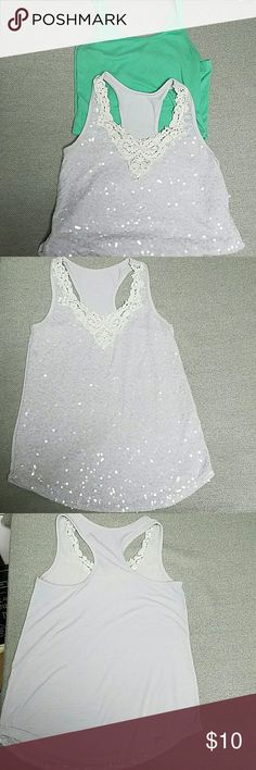 Small Tank Top Bundle! The green one is Old Navy, made with cotton modal and spandex, good condition with minor pre-pilling. The sparkly one is unknown brand, made with cotton rayon and spandex, sequins on the front with a lace detail, good condition with minor pre-pilling. Tops Tank Tops