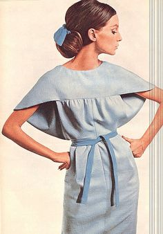 Early 60s space age pale blue cape back unique design MCM hair belt model Beate Schulz in a Vogue Pattern dress, photo by David Bailey, 1964