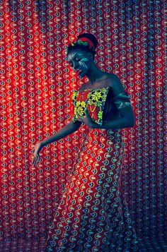 One of Each African accessory brand clutch bag featured in red print on print fashion editorial Photo: Claire Gunn