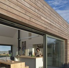 Russwood's Siberian Larch (SILA) is a popular timber cladding choice for its aesthetic beauty, excellent durability, high density & impressive lifespan. Wooden Cladding Exterior, Wooden Wall Cladding, Exterior Wall Panels, Larch Cladding, House Cladding, Cladding Design, Bungalow Extensions, External Cladding, Architecture Details