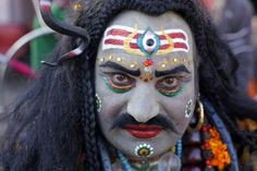 An Indian man, dressed as Hindu God Lord Shiva, participates in a procession during the annual cattle fair in Pushkar, Rajasthan, India, Saturday, Nov. 24, 2012. Pushkar, located on the banks of Pushkar Lake, is a popular Hindu pilgrimage spot that is also frequented by foreign tourists who come to the town for the annual cattle fair and camel races. (AP Photo/Rajesh Kumar Singh)