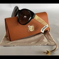 "TORY BURCH Sunglasses Adorable Tory BURCH sunnies. Black frame with Tan wood grain look sides. Approx 5 3/4"" across. Drawstring pouch and case included!  NWT Tory Burch Accessories Sunglasses"