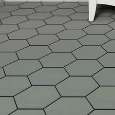 EliteTile Hexitile features a hexagonal shape that is perfect for historical renovations or modern installations. Being impervious to water, these tiles are ideal for backsplashes and even offer frost resistance for some exterior work. Hexagon Tile Bathroom, Black Hexagon Tile, Bath Tiles, Hexagon Tiles, Bathroom Flooring, Grey Wall Tiles, Wall And Floor Tiles, Small Bathroom Paint, Master Bathroom