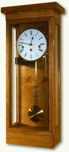 Fordel from Clocks and Chimes - in Ash, Beech, Cherry or Oak.  This is a contemporary Vienna Regulator style wall clock, with a simple straight line mission design. The cabinet is handcrafted from locally sourced sustainable British hardwoods and is finished with Danish oil to produce delightful colour, quality sheen and pleasing tactile feel.  The superb case is fitted with a quality German movement form Hermle.