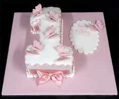 Themed birthday cake - 55 ideas year baby - baby girl birthday cake in the shape of a number 1 decorated with pink butterflies 1st Birthday Cake For Girls, Butterfly Birthday Cakes, 7th Birthday Cakes, Birthday Parties, Birthday Ideas, Cake Images, Cake Pictures, London Cake, Baby Girl Cakes