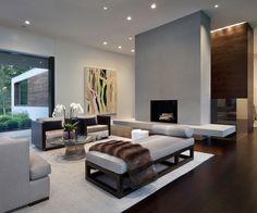 Remarkable-modern-home-interior-elegant-design-living-room-Gray-colored-carpet-luxury-design-Gray-color-sofa-sets-brown-fur-blanket-minimalist-design-length-sofa-beds-modern-round-glass-table-details