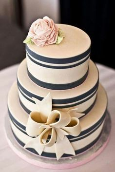 So elegant.  But would need to be bright white.  Definitely a fondant bow, but could the rest be done in buttercream?