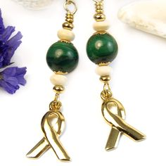 Featuring malachite gemstone beads, these green awareness earrings with gold-tone ribbons offer an earthy elegance in this meaningful style of jewelry. The malachite rounds are an eye-catching size Handmade Beaded Jewelry, Wire Jewelry, Earrings Handmade, Jewelry Crafts, 90s Jewelry, Fashion Jewelry, Green Gemstones, Malachite, Designer Earrings