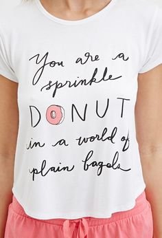 """This statement tee says """"You are a sprinkle donut in a world full of plain bagels."""" Material: Poly/Elastane Blend"""