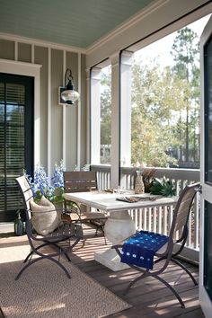 Great porch. Love the turquoise ceiling and the details on the walls and great columns.