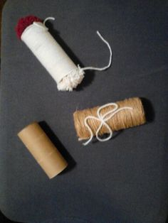 Diy cat toys: toilet paper roll filled with bell & catnip then wrapped with string.