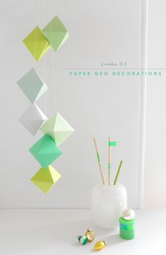 "[DIY] These hanging ""paper geo decorations"" are made from a free printable template that is printed on heavy weight paper. The template can be printed on your choice of colored paper, glued together, and hung using white thread and tape."