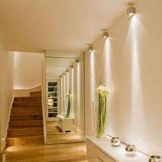 Decoration,Swanky Modern Hallway Wall Narrow Lighting Design Ideas With White Color Wall Interior Feat Wall Mirror And Beauty Flower Decorated Combine Wooden Railing Stairs,Incredible Hallway Lighting For Wall And Ceiling Decoration Ideas Hall Lighting, Hallway Walls, Hallway Wall Lights, Hallway Lighting, Rustic Ceiling Lights, Hallway Ceiling, Hallway Wall Decor, Stair Lighting, Hallway Ceiling Lights