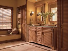 style and storage abound in this luxurious master bathroom where a bath accent collection adds extra flair to cabinetry in the bathing and dressin