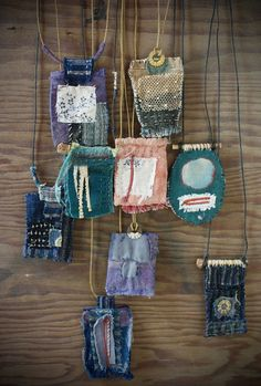 colorful fabric pendants on a worn piece of woodroad sewing, feedback loops and accidental amulets - ann wood handmadeContinents and centuries collide in these hand stitched amulets assembled from antique scraps. Fiber Art Jewelry, Textile Jewelry, Fabric Jewelry, Textile Art, Jewelry Art, Jewellery, Fabric Beads, Fabric Art, Fabric Scraps