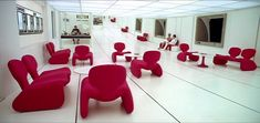 Kubrik's gorgeous visual sense is evident in 2001: A Space Odyssey's Space Station One waiting room set - the gorgeously futuristic Djinn chairs (designed by Olivier Mourgue in 1965) come to life against the stark black and white surroundings...