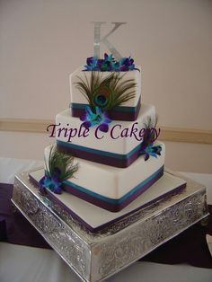 I like this cake with but with out the feathers. add a little more bling and different flower it will be on point!