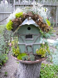 Here's an inspiration....a birdhouse with a roof half cut out for flowers and plants. And you can add the decor of the trimmings on the front!