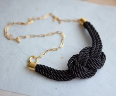 Knot necklace //  http://www.etsy.com/listing/89886737/black-nautical-knot-rope-necklace-with?ref=v1_other_2