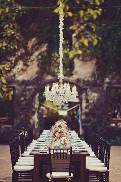 elegant tablescape with a chandelier - photo by Tamiz Photography http://ruffledblog.com/sophisticated-hawaiian-wedding-at-haiku-mill #weddingreception #receptions