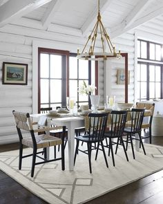 This dining room has a rustic feel but chic look. We love the iconic wooden chairs, patterned abaca chairs, and patterned rug.