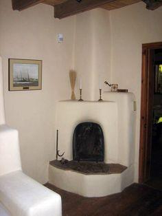 Kiva fireplace in Taos Earthship   Book Research   Pinterest ...