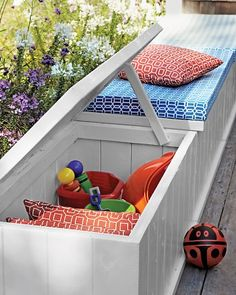 Make Storage Multitask (pool area?)  Solve two outdoor problems -- a lack of seating and of storage -- at once. Transform wooden chests with paint and custom cushions made of waterproof foam and fabric.