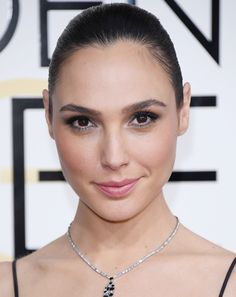 Gal Gadot wears a sleek pony and no-makeup makeup at the 74th Golden Globes