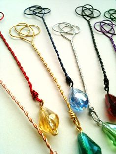 something similar. im thinking chakra wands suspended from the ceiling in my magick room to align with the power points when i lay flat