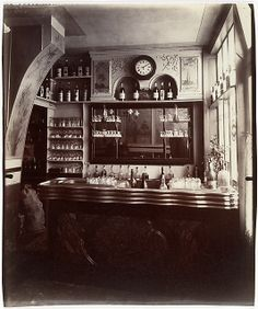 """Eugène Atget, (French, 1857–1927). Marchand de Vin, Rue Boyer, Paris, 1910-11. The Metropolitan Museum of Art, New York. Gilman Collection, Purchase, Joseph M. Cohen Gift, 2005 (2005.100.548)   This photograph is featured in """"Paris as Muse: Photography, 1840s–1930s,"""" on view through May 4, 2014. #paris"""
